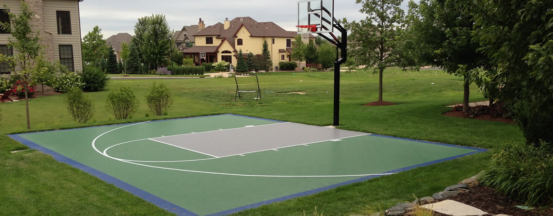 Power court backyard basketball courts sports for Building a half court basketball court