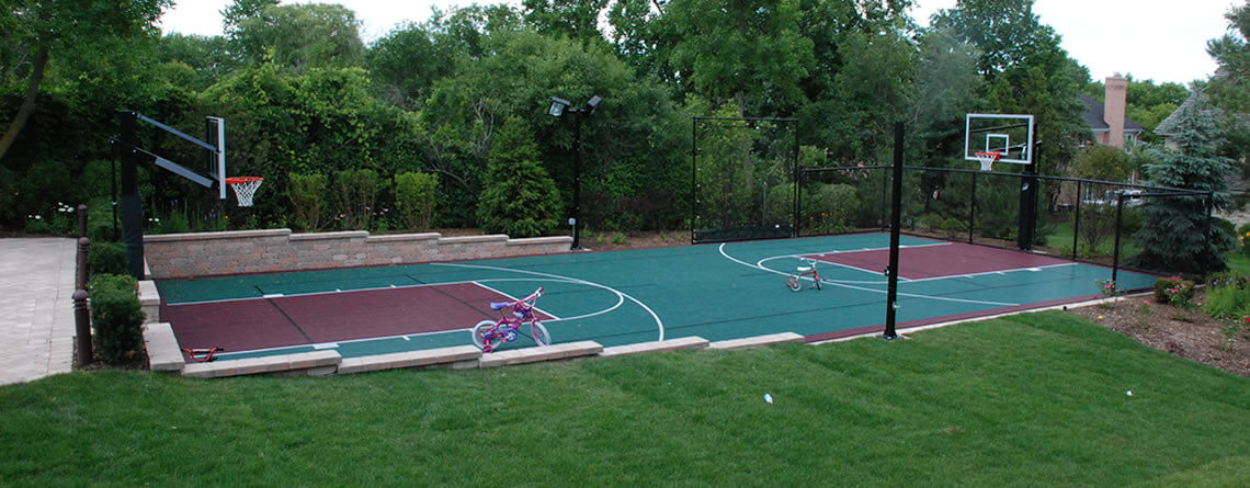 Outdoor basketball court builder power court for Backyard sport court